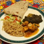 Rice, curry, nan bread and salad