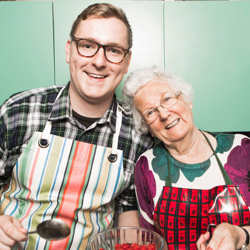 Younger male cook with older woman
