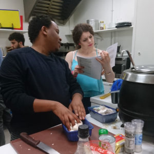 Young people cooking in large kitchen