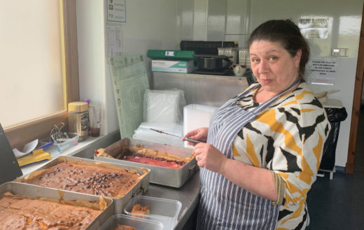 Woman cutting up tray bakes