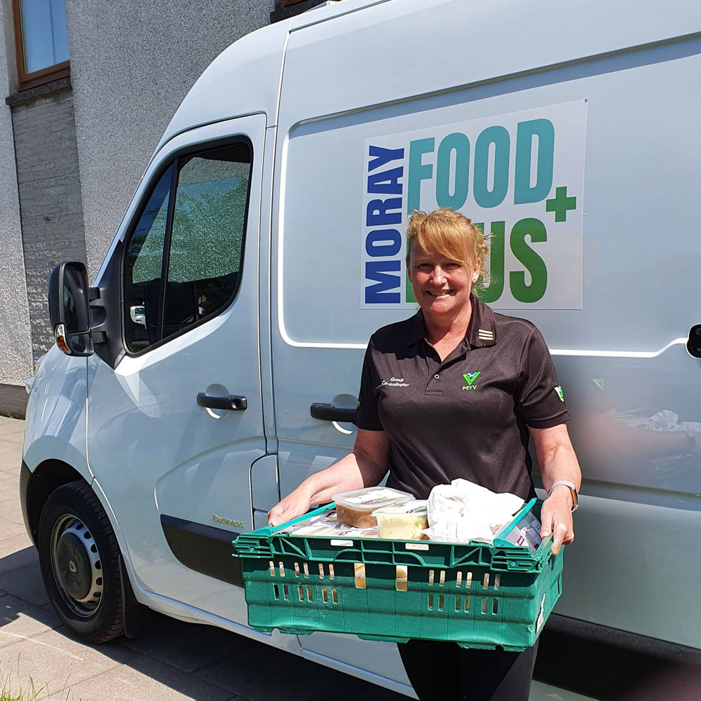 Moray Food Plus van and woman deliverer with tray of goods