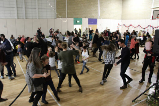 People dancing at a busy ceilidh